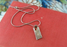 Textured silver with carnelian